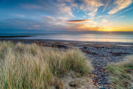Sunrise over the sand dunes at New England Bay near Stranraer on the west coast of Scotland