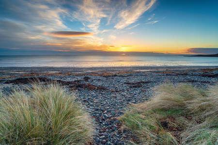 Beautiful sunrise over the beach at New England Bay on the west coast of Sotland near Stranraer
