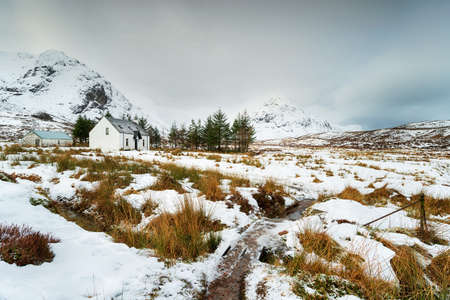 A mountain croft in the snow at Glencoe in the Scottsih Highlands Stock fotó