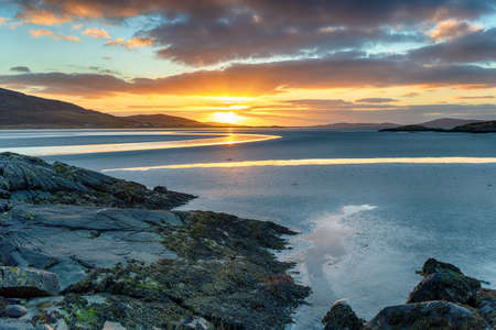 Beautiful sunset at low tide over Luskentyre beach on the Isle of Harris in the Western Isle of Scotland