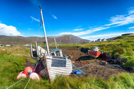 Old fishing boats at Leverburgh on the Isle of Harris in Scotland
