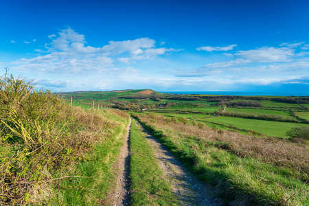 Looking out over the Purbeck Hills to the sea from the top of Grange Hill near Creech on the Dorset coast Stock fotó