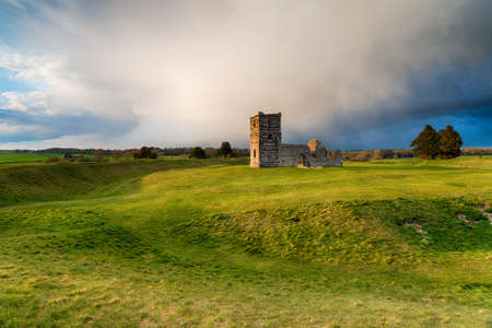 Dramatic skies over the old church at Knowlton near Wimborne in the Dorset countryside Stock fotó