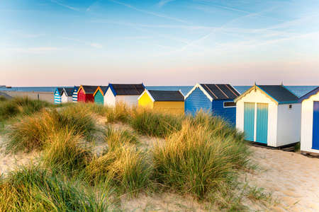 Pretty beach huts in the sand dunes at Southwold on the Suffolk coast