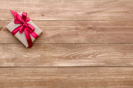 valentina: gift on wooden background