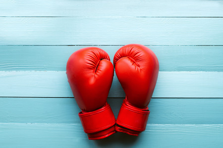 red boxing gloves on a blue background