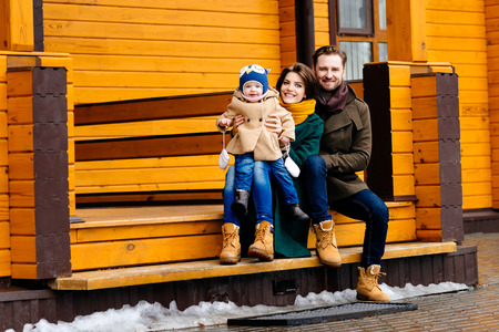 cosiness: happy family against a country house Stock Photo