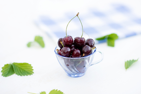 unloading: Ripe, juicy sweet cherry in a glass Stock Photo