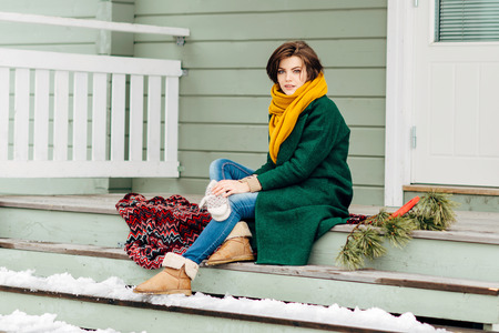 country house style: the beautiful girl in warm clothes