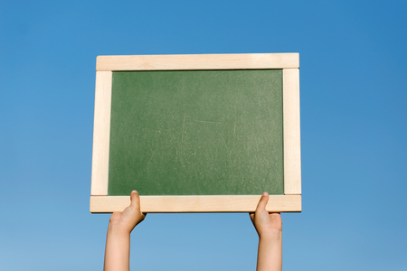 planck: board or background in hands of the person Stock Photo