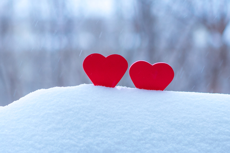 two beautiful hearts on a winter background Stock Photo
