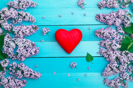 red heart against the background of with flowers Stock Photo