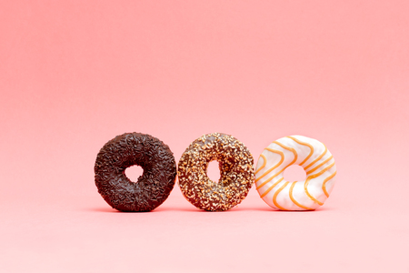 lots of beautiful donuts on blue background