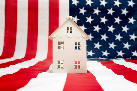 house on American flag background Banco de Imagens