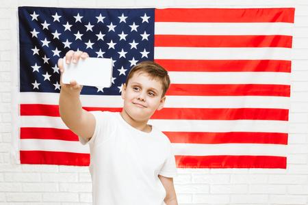 boy making selfie on american flag background