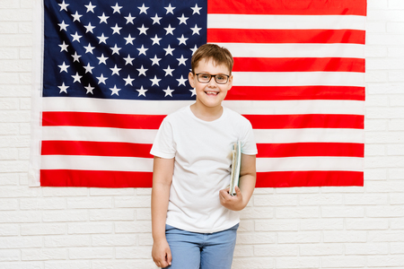 happy american student on flag background