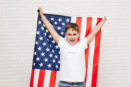 happy boy on american flag background