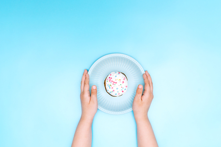 cake on a blue plate held by a man
