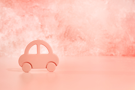 pink car on a pink background