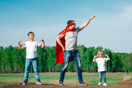 super-dad with son and daughter in the summer in nature Banco de Imagens