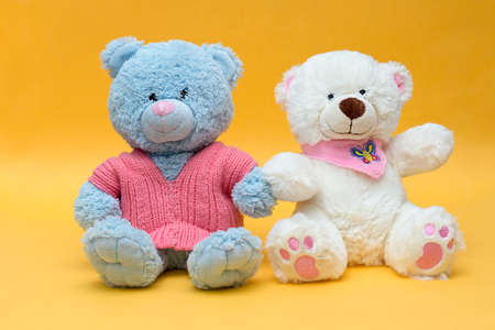 two teddy bears hold hands Stock Photo