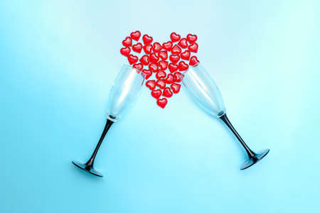 two beautiful wine glasses with hearts inside as a symbol of love