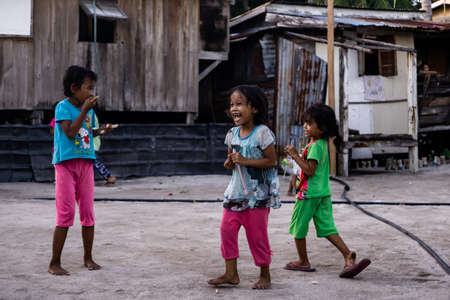 Mabul Island, Sabah, Malaysia - Aug 08, 2018: A happy face and enjoy of the Kids life on Mabul Island, they play with everything around them 報道画像