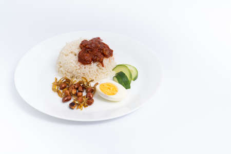 Nasi Lemak-Malaysian cuisine. A fragrant rice dish cooked in coconut milk and pandan leaf commonly found in Malaysia. A white background provides copy space to the Imagens