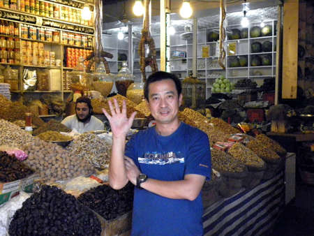 karachi: CHINESE MAN_SHAKING HIS HANDS_IN THE DRY FRUITS MARKET TODAY ON FRIDAY 932012 _SADDAR KARACHI PAKISTAN