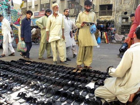 SADDARKARACHIPAKISTAN_ MEN SHOESSANDALS|_SHOP ON THE ROAD IN COMMERCIAL MARKET TODAY ON  FRIDAY MARCH 932012                            Editorial