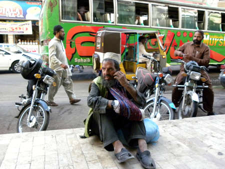 BEGGER_POOR HUNGRY OLD MAN BEGGER_ OUTSIDE OF THE RESTAURANT ON FOOTPATH TODAY ON SATURDAY 1032012 KARACHIPAKISTAN