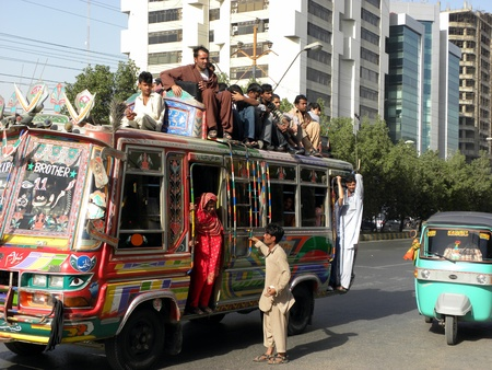 LOCAL_PUBLIC_SITTING ON THE BUS_ROOF_DUE TO_UN SPACE_IN BUS_TODAY ON THURSDAY_1532012_ KARACHIPAKISTAN