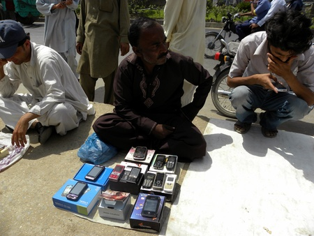 thursday: PAKISTANKARACHI_LOCAL  MENS SALES ARE SALES NEW AND SECOND HAND MOBILE PHONES ON THE FOOTPATH TODAY ON THURSDAY 5 APRIL 2012