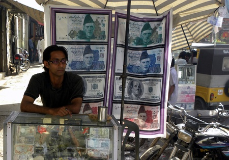 PAKISTANKARACHI_LOCAL MONEY CHANGER SITTING ON STALL IN THE BOLTAN MARKET TODAY ON MONDAY 9 APRIL 2012