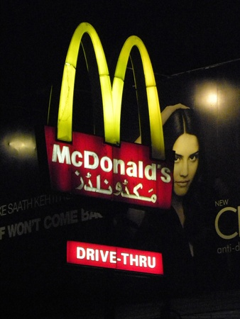 PAKISTANKARACHI_MCDONALS CORPORATION IS ONE OF THE MUST LARGEST CHAINS OF FAST FOOD RESTAURANTS IN THE WORLD THE YELLOW M WITH ITS GOLDEN ARCHES IS ONE OF THE MOST WELL KNOW COMMERCIAL SIGNS IS ALSO A AYMBOL FOR CUSTOMERS TODAY ON MONDAY 16 APRIL 2012