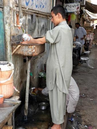 PAKISTANKARACHI_LOCAL BOY IN CHILD LABOUR DOING DISHWASHING TEA CUPS TODAY ON  TUESDAY 1 MAY 2012 I KARACHI