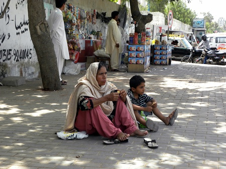 PAKISTANKARACHI_WOMAN AND HER SON SITTING ON GROUND DUE TO UNAVAILABLE SPACE IN HOSPITAL FOR VISITOR TODAY ON FRIDAY 11 MAY 2012 IN KARACHI