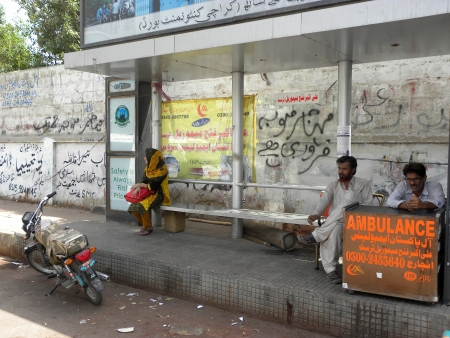 PAKISTANKARACHI_YOUNG GIRL SITTING ON BUS STOP AN WAITING FOR BUS TODAY ON SATURDAY 12 MAY 2012 IN                                Editorial