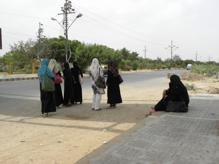 PAKISTANKARACHI_STUDENT GIRLS STANDING AT BUS  STOP,WERE WAITING FOR THEIR BUS OUT SIDE OF UNIVERSITY OF KARACHI TODAY ON THURSDAY 21 JUNE 2012 IN KARACHI