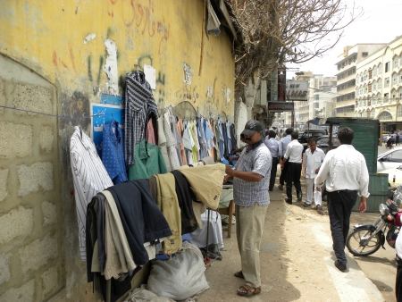 PAKISTANKARACHI_LOCAL PEOPLE CHECKING SHIRTS FROM FOOTPATH STALL TRYING TO BUY LOW PRICE SHIRTS ARE USED SHIRT TODAY ON FRIDAY 22 JUNE 2012                                                                                  Editorial