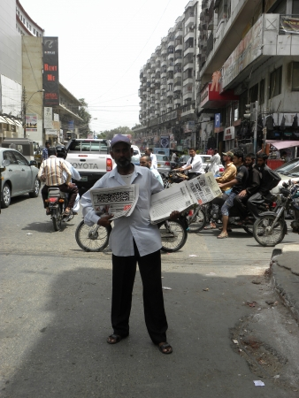karachi: PAKISTANKARACHI_LOCAL NEWS PAPER MAN IS SALING NEWS PAPER AT TRAFFIC SIGNAL TODAY ON SUNDAY 24 JUNE 2012 IN KARACHI