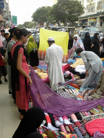 PAKISTANKARACHI_PAKISTANI YOUNG GIRLS BUYING CLOTH FABRIC FROM STALL SHOP IN MARKET TODAY ON WEDNESDAY 18 JULY 2012 IN KARACHI TARIQ ROAD                                    Editorial