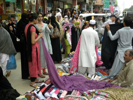 PAKISTANKARACHI_PAKISTANI YOUNG GIRLS BUYING CLOTH FABRIC FROM STALL SHOP IN MARKET TODAY ON WEDNESDAY 18 JULY 2012 IN KARACHI TARIQ ROAD