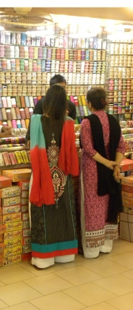 shop keeper: PakistanKarachi_Young Pakistani Females Watching Beauitfull an Fancy fashion Bangles At Bangles Store Today on Thursday 19 2012 in Karach                       Editorial