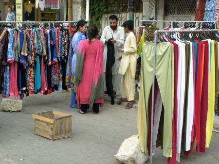 PAKISTANKARACHI_PAKISTANI YOUNG FEMALES BUYING FASHINABLE DRESSES FROM STALL SHOP TODAY ON FRIDAY 20 JULY 2012 IN KARACHI