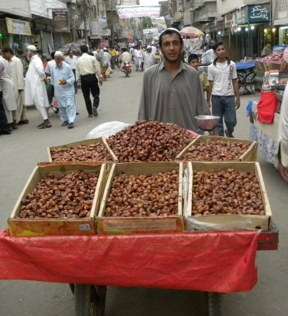 PAKISTANKARACHI_STREET VENDOR SELLING DATES IN THE STREET IN THE HOLY MONTH OF RAMADAM TODAY ON TUESDAY 24 JULY 2012 IN KARACHI                                Editorial