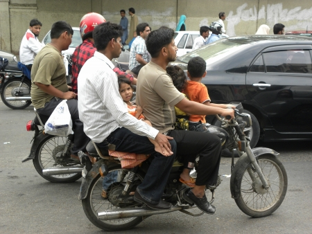 PAKISTANKARACHI_IN PAKISTAN PEOPLE SITTING ON BIKE MORE THEN TWO PEOPLE USUALLY WITHOUT HELMETS CAN BE DENGEROUS ON BIKE  TODAY ON TUESDAY 24 JULY 2012 IN KARACHI                     Editorial