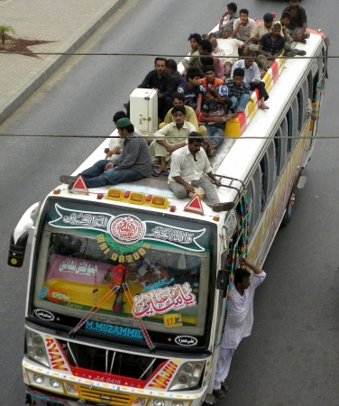 PAKISTANKARACHI_LOCAL PASSENGERS SITTING ON BUS TOP ROOF DUE TO UN SPACE IN BUS AND ALSO TO ENJOY TO SITTING ON ROOF TODAY ON THURSDAY 9 AUGUST 2012 Editorial