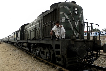 PAKISTANKARACHI_NATIONAL PASSENGER TRAIN PASSING THROUGH RAILWAY TRACKS TODAY ON THURSDAY 23 AUGUST 2012 IN KARACHI KALA PUL