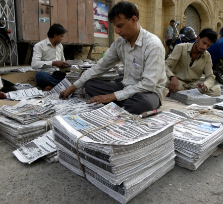 current events: KARACHIPAKISTAN_NEWSPAPPER DISTRIBUTOR ARRANGING  NEWSPAPER AT NEWS DISTRIBUTOR POINT A NEWSPAPER IS A SCHEDULED PUBLICATION CONTAINING NEWS OF CURRENT EVENTS. HERE ON THURSDAY 4 OCTOBER 2012                               Editorial